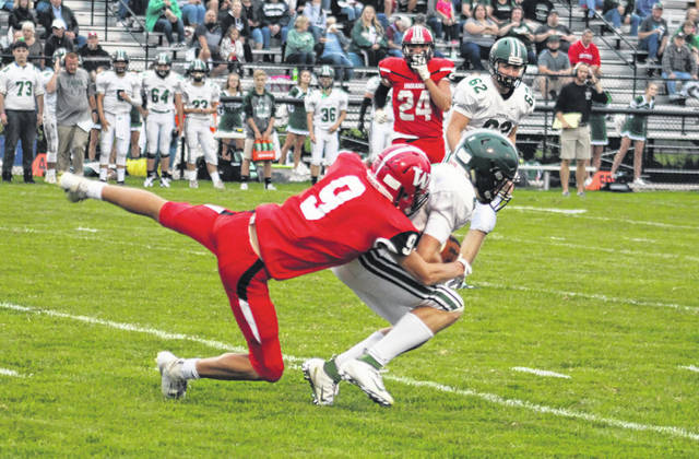 Wauseon's Jonas Tester brings down Max Grube of Tinora on a kickoff during Friday's game. After falling behind early, the Indians went on to rout the Rams 32-6.