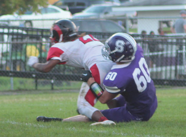 Brendan Keith of Swanton takes down Tyrelle Devault of Rogers in the backfield Friday night. The Bulldogs captured their first win of the season, besting the Rams 19-7.