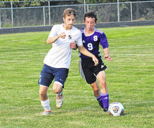 Josiah Kindinger of Archbold, left, and Swanton's Zach Wernsing vie for a loose ball during a NWOAL boys soccer game Tuesday. The Blue Streaks bested the Bulldogs 7-1.
