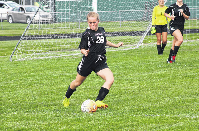 Delta's Kayla Kunar boots one away from the Panther goal Tuesday in a game against Toledo Christian. The Panthers were shut out by the visiting Eagles, 2-0.