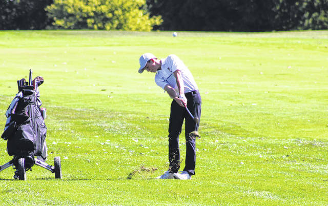 Pettisville's Max Leppelmeier goes for the green with a shot on the eighth hole Thursday while competing at a Division III sectional tournament at Eagle Rock Golf Course. Leppelmeier earned medalist honors for the tournament, shooting a 74.