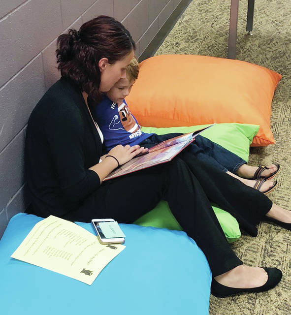 David Alexander and his mother, Bridgette, spend time with a book at the Family Reading Night event during last year's Delta Elementary School Right to Read Week.