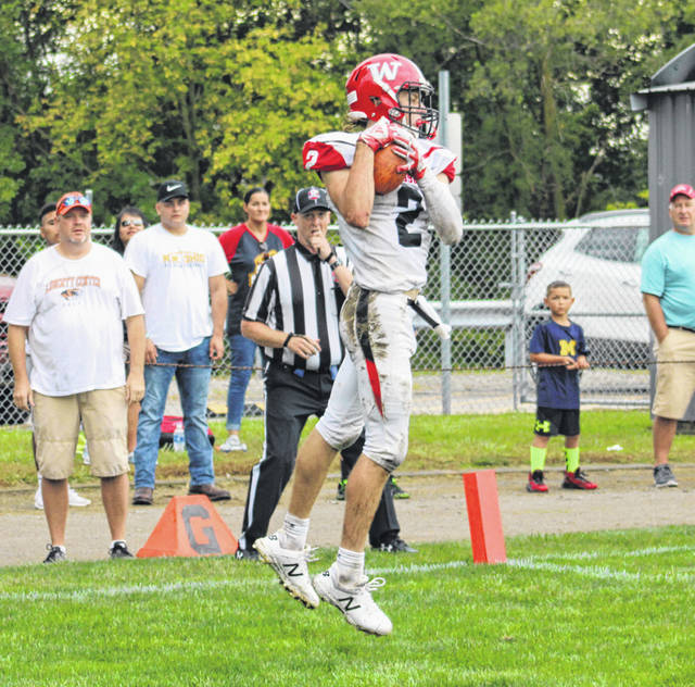 Wauseon's Connar Penrod with a touchdown catch with a second remaining in the first half Saturday versus Liberty Center. Penrod caught three TDs but the Indians fell to the Tigers, 35-29.
