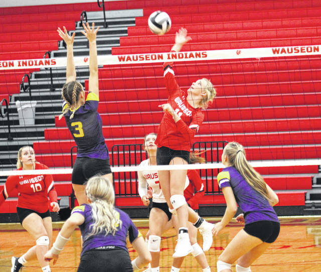 Wauseon's Chelsie Raabe smacks one over the net during a NWOAL match with Bryan Tuesday night. The Indians fell in a competitive five set match, dropping their record in the league to 2-2.
