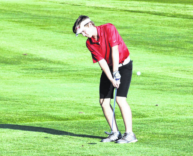 Jaxon Radabaugh of Wauseon with a shot from the fairway on the 13th hole during Monday's NWOAL tri-match with Archbold and Liberty Center at Ironwood. Radabaugh and teammate Dylan Grahn paced the Indians as each shot a 42, however, they fell to Archbold by one stroke.