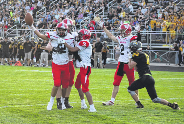 Wauseon's Noah Tester and teammates celebrate following his six-yard touchdown reception to give them a 7-0 lead over Fairview in the second quarter of Friday's game. The Indians went on to defeat the Apaches 17-14.