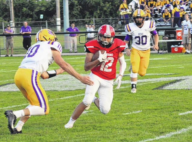 Wauseon's Noah Tester goes over the middle for a first down reception Friday in the NWOAL opener with Bryan. The Indians improved to 4-0 with a 14-7 win over the Golden Bears.