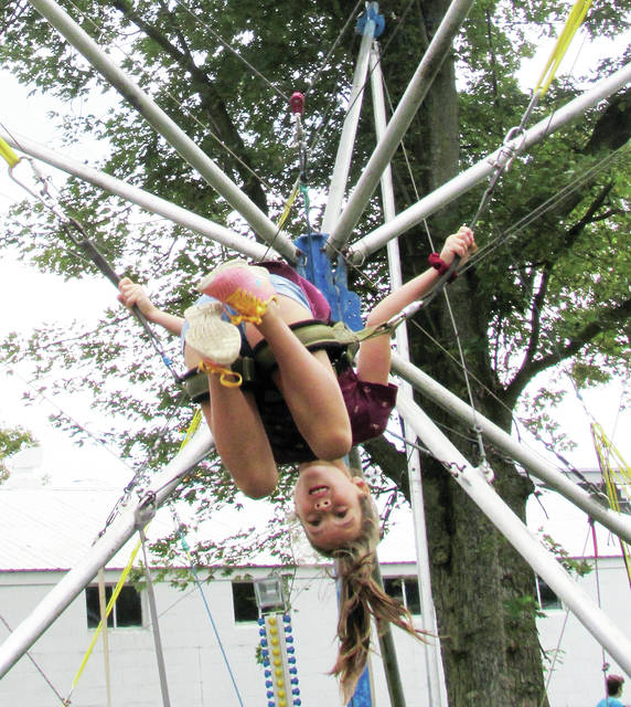 Molly Harris, 8, of Pettisville struts her athletic ability on the bungi cords.