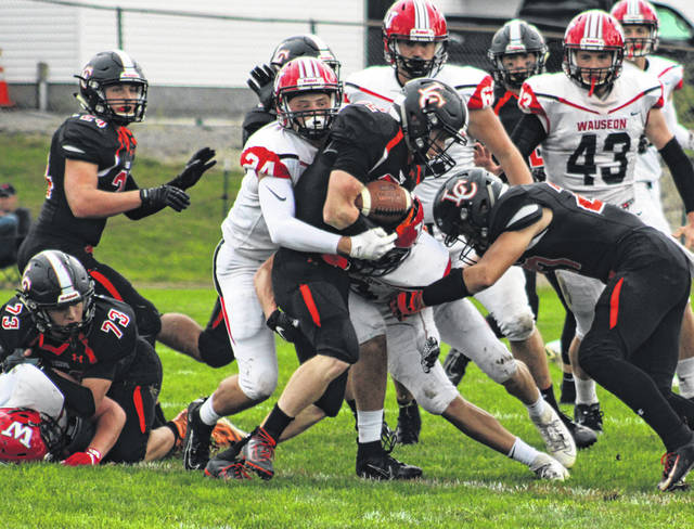Sean Brock of Wauseon assists on a tackle of Liberty Center's Zach Bowers during Saturday's game. Wauseon is currently ranked fourth in the OHSAA computer rankings for Division IV, Region 14.