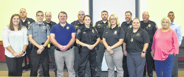 Those that completed a week-long Crisis Intervention Team training last month were, front row from left, Bethany Shirkey, instructor, ADAMhs Board; Officer Bradley Cash, Swanton Police Department; Justin McCall, chaplain Montpelier Police Department; Officer Madelyn Griffin, Wauseon Police Department; Probation Officer Ashley Bowen, Napoleon Municipal Court; Probation Officer Kelly Tietje, Bryan Municipal Court; and Drena Teague, CIT coordinator. And back row from left, Napoleon Police Chief Dave Mack, instructor; Deputy Tim Dennie and Lt. Clifton Vandemark, Defiance County sheriff department; Sgt. Steven Waxler Jr., Fulton County Sheriff department; Randy Luke and Kim Shaffer, Community Hospitals and Wellness Center security officers; and Napoleon Police Department Detective Jamie Mendez, instructor. David Riker, superintendent of the Northwest Ohio Juvenile Detention Center, participated in the class but is not pictured.