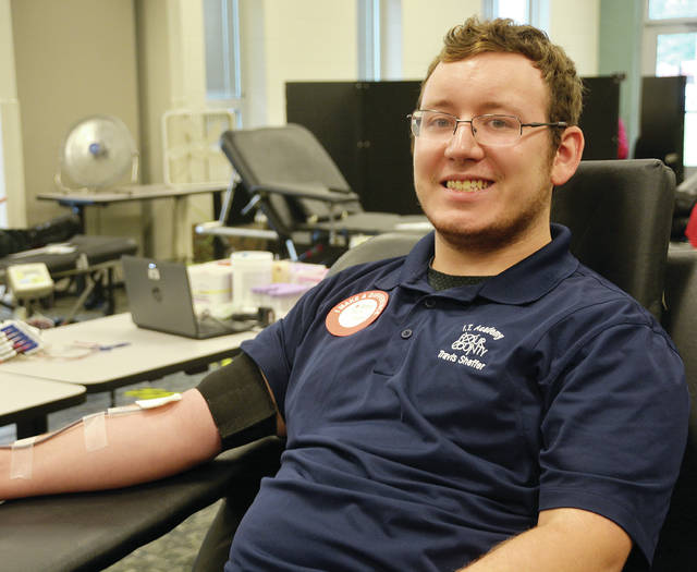 Four County Career Center students in Archbold recently donated blood during the HOSA Future Health Professionals-sponsored Red Cross blood drive. HOSA members planned and coordinated the drive and assisted with donor registration, testing, and blood donations. Ninety-four units of blood were collected. Shown giving blood is Travis Sheffer of Wauseon in the Computer Networking and Cybersecurity program.