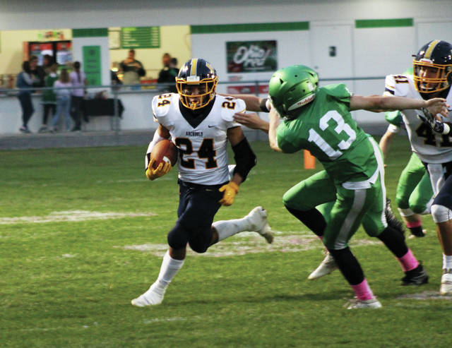 Noah Gomez runs the ball for Archbold Friday night in a 42-7 win over Delta. It was Gomez' first game back from injury after missing the previous four weeks.