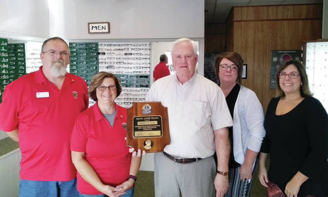 Dr. Kenneth Kling of Wauseon has been presented a Melvin Jones Fellowship by the Wauseon Lions Club. The fellowship is in honor of the Lions Club's international founder, Melvin Jones, and is the highest honor the club can bestow on someone for a $1,000 donation to the Lions Clubs International Foundation. Pictured, from left, are Wauseon Lions Club First Vice President Mark Eddings and Treasurer Sheryl Burnett; Dr. Kling; and staff members Lisa Villalovos and Audrey Courtney.