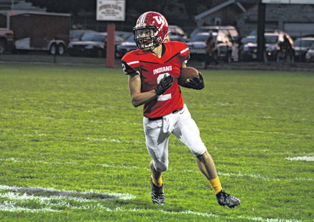 Connar Penrod of Wauseon runs one around the left side during last Friday's game versus Patrick Henry. The Indians are now first in the OHSAA computer rankings for Division IV, Region 14.