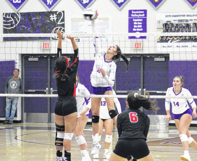 Swanton's Alexis Sarvo hits one over the net in a non-league match against Cardinal Stritch this season. Sarvo was tabbed as the NWOAL Player of the Year.
