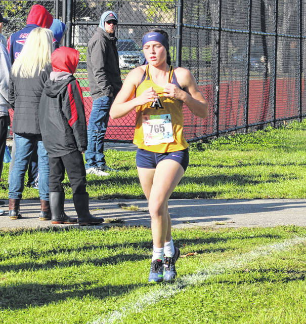 Kylie Sauder of Archbold runs at the NWOAL meet earlier this month. She finished third overall at the Tiffin Regional Saturday, helping the Blue Streak girls advance to state in Division III.