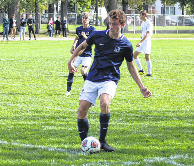 Trey Theobald of Archbold passes one upfield Saturday in a sectional final win over Genoa. He had a pair of goals in the victory.