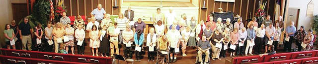 First Christian Church in Wauseon held a Volunteer Recognition event Sept. 22 honoring over 130 volunteers who accumulated over 800 hours of service. Pictured are –front row, from left – Kendall Vickery, Cynthia Vickery, Jerry Kingsbury, Wendy Kingsbury, Phyllis Burkholder, Vanessa Bradner, Kelly Baumgartner, Nancy Ayers, Lori Schroeder, Jessica Arend, Shaun Arend, Ed Barnes, Carlos Bowers, Vivienne Boyers, Resa Frey, Bernie Bronsink, Mark Miller, Julie Peebles, Linda Thompson, Martha Powers, Don Durham, Kim Cupp, Steve Brannan, Bill Blanchong, Tina Blanchong, Bill Frank, Sarah Powers, Janet Powers – second row, from left – Dan Burkholder, Jayne Ferreira, Tim Andrews, Yvonne Baumgartner, Kathy Snyder, Rodney Smith, Rhonda Snipes, Julie Engler, Wilma Bostelman, Pat Miller – third row, from left – Ken Baumgartner, Dick Snyder, Sue Weiler, Jim Smith, Casey Smith, Joyce Summers, Kay Roth, Mark Powers, Sharry Boyers, Sally Lutz, Pat Marks, Deb Gleckler, Lucas Lerma, Jim Williams.