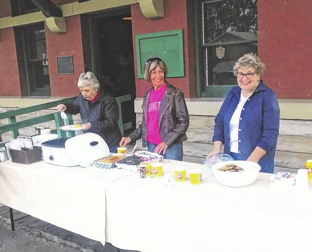 The Hobo Festival was held Saturday at the Wauseon Depot. Hobo dinner is served, from left to right, by: Kay Roth, Norma Shoemaker, and Bev Ernst. Attendees also had the opportunity to meet a hobo, hear tales of life traveling the country by jumping on and off train cars, and listen to live entertainment.