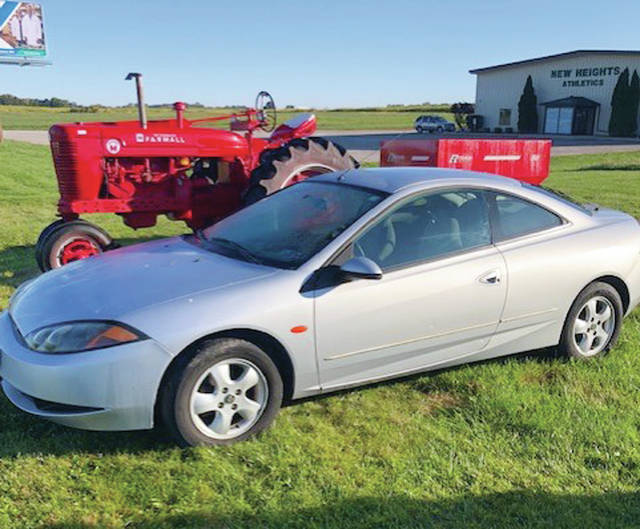 This antique tractor and automobile are just two of thousands of items to be auctioned at the 58th Annual Wauseon Rotary Auction on Saturday.