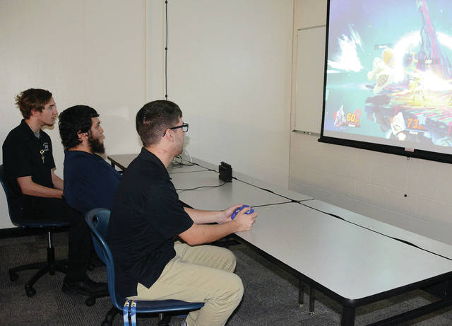 Four County Career Center eSports Super Smash Bros. team members, from left, Michael Montgomery of Patrick Henry, Enrique Gomez of Patrick Henry, and Mason Young of Holgate in competitive mode.