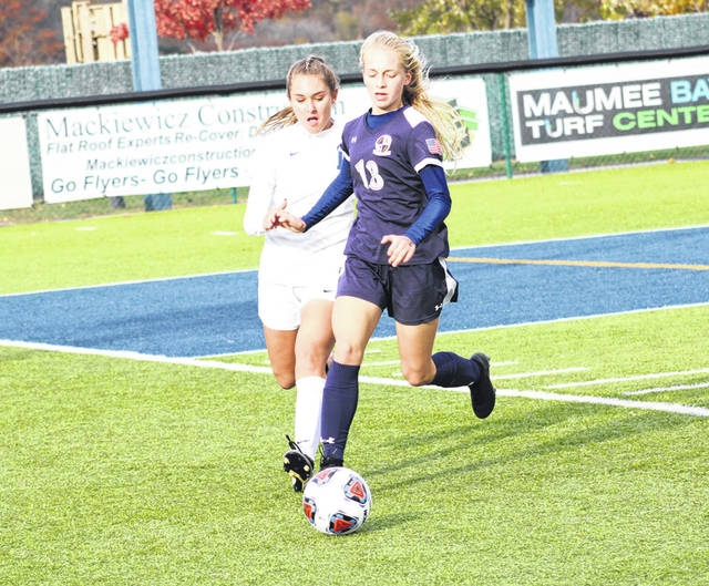 Archbold's Kalyn Baker gets to a ball on Saturday versus Liberty-Benton in a Division III girls soccer regional final. The Blue Streaks fell to the Eagles 2-1.