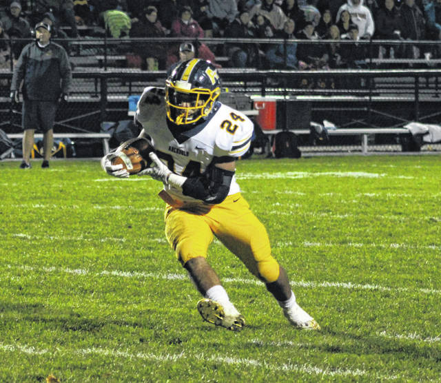 Archbold running back Noah Gomez puts his foot in the ground and cuts upfield during Friday's game at Wauseon. He rushed for 197 yards and two long touchdowns in the Blue Streaks' 38-0 shutout of the Indians.
