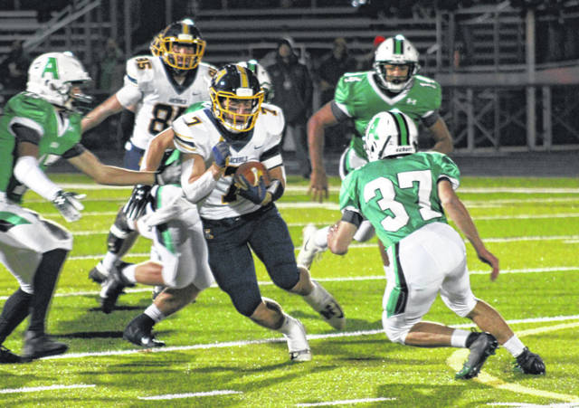 Caleb Hogrefe of Archbold runs for a first down on the Blue Streaks' opening possession versus Anna Friday in a Division VI regional championship played at Spartan Stadium in Lima. They saw their season come to an end by way of a 42-7 loss to the Rockets.