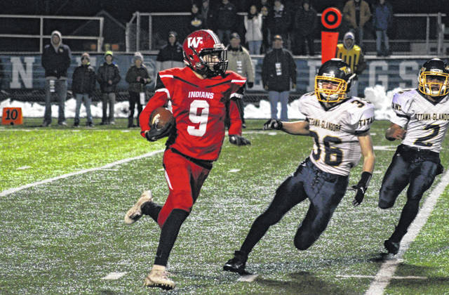 Wauseon's Jonas Tester takes a kick return upfield in a Division IV, Region 14 semifinal versus Ottawa-Glandorf at Defiance Saturday night. The Indians saw their season come to an end, falling to the Titans 21-14.