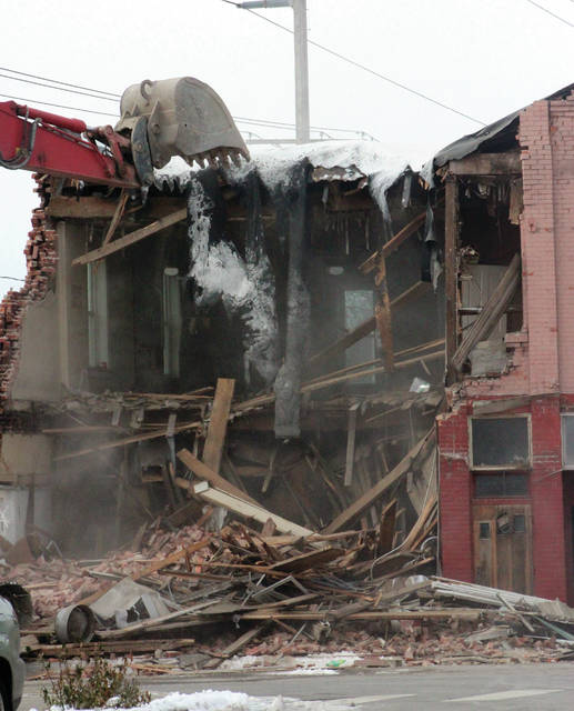 The building at 91-93 N. Main Street in Swanton comes down on Wednesday.