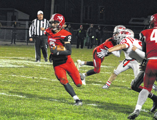 Wauseon's Connar Penrod runs for a first down Saturday in the opening round of the Division IV playoffs versus Bellevue. Penrod caught nine passes for 297 yards, breaking the single-game school record for receiving yards while also catching four touchdowns. The Indians defeated the Redmen 41-18.