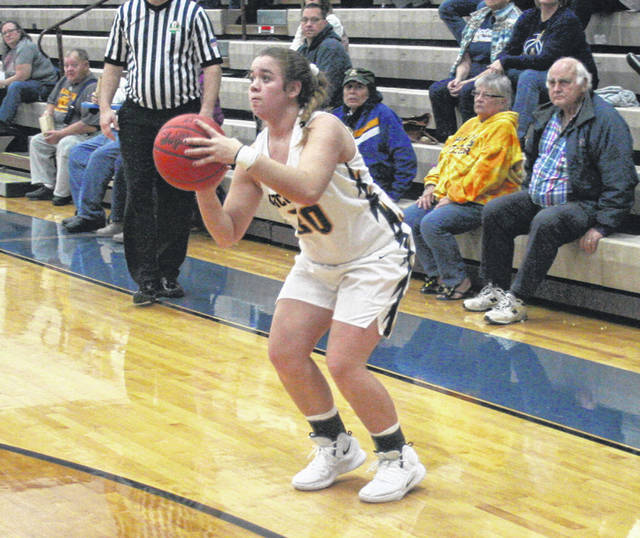Archbold's Harley Phillips attempts a three-pointer during a game last season. Phillips is back for the Blue Streaks after averaging 4.8 points per game in 2018-19.
