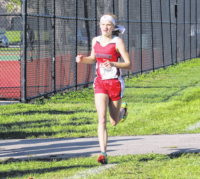 Grace Rhoades of Wauseon runs at the NWOAL meet this season. This past weekend at the state cross country meet in Hebron, Ohio, she placed 40th in the Division II girls race.