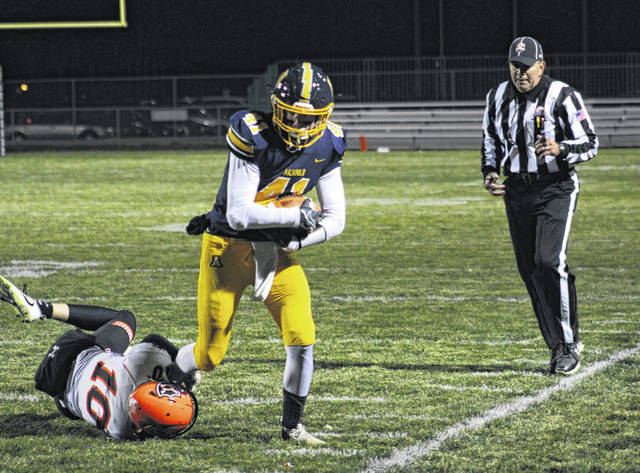 Spencer Short catches one for Archbold near the sideline for a minimal gain in the opening round of the playoffs against Coldwater Friday. The Blue Streaks, behind Elijah Zimmerman's 28-yard touchdown in the closing seconds, defeated the Cavaliers 27-21.