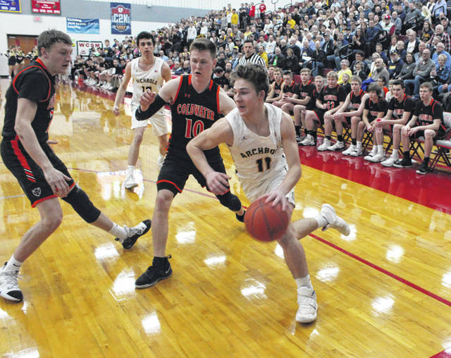 Elijah Zimmerman of Archbold drives along the baseline in a tournament game last season. He is the main returnee for the Blue Streaks this season, coming off a 2018-19 campaign where he averaged 9.7 points per game.