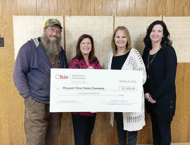 The Ohio Dept of Commerce presented Pleasant View Union Cemetery officers with a $1,000 grant Oct. 31. Pictured, from left, is Dan Shock, sexton; Anne Petit, superintendent, Ohio Dept of Commerce; Marcia Franks, clerk-treasurer; Abigail Bieber, trustee.