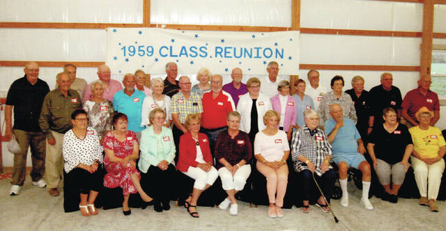 Wauseon High School Class of 1959 member Bee Neuenschwander's barn was buzzing with activity Sept. 7 during the class's 60th reunion. Good conversation abounded during the evening as classmates reminisced about their first automobiles. Pictured are - first row, from left - Pat Armstrong Murray, Vickey Denn Finn, Margaret Pigott Crowell, Marietta Andrews Ray, Betty Rupp Rathbun, Linda Gorsuch Gerken, Aletta Gype Dielman, Bill Hinkle, Carolyn Secondeast Leitner, Louise Lind Gilson - second row, from left - Bee Neuenschwander, Suzie Trejo Gueuro, Dale Tanner, Sadonna Stewart Colon, Leslie Nafziger, Don Aeschliman, Beverly Precht Ernest, Lou Ann Richer Kanagy, Judy Hoffman Potes, Carol Smith Schmitz, Allen Upp, Tom Hallet, Milton Zimmerman - third row, from left - Phil Lillich, John Pugh, Dale Creager, Bonnie Holliker Creager, Bob Salsberry, Ruth Ann Paxson Vereeke, Dick Kinney, Jim Saunders, Butch Hoffman.