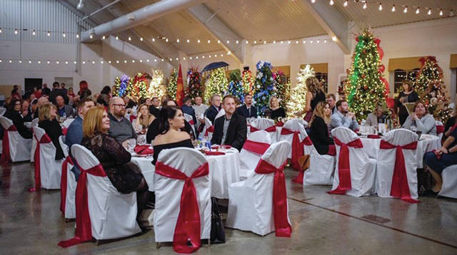 A total of 184 people attended Friday's Sugar Plum Ball, where decorated Christmas trees were auctioned.