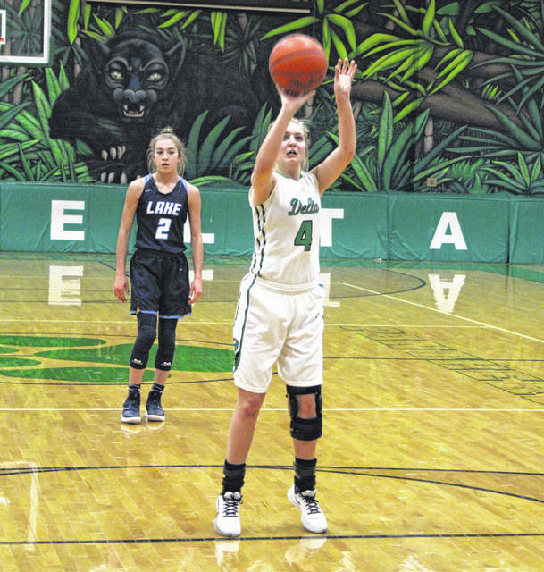 Delta's Braelyn Wymer splits a pair of free throws during Monday's home game against Lake. A strong second half pushed the Panthers over the Flyers, 51-38.