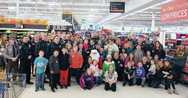 Fifty-one area children participated Dec. 14 in the annual Christmas for Kids in Fulton County. Youths from all seven county school districts were treated to a breakfast provided by McDonald's at the Wauseon Fire Department, then traveled by emergency vehicles gathered from around the county to Walmart, where they each received a $100 gift card for a holiday shopping spree.