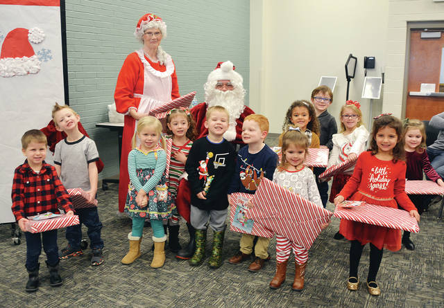 Four County Career Center Preschool/Childcare Center students presented their annual Christmas program for parents and grandparents. The Early Childhood Education students at FCCC work with the children as part of their lab experience and led them in the program. Shown during the program with Santa and Mrs. Claus are - front, from left - Brazen Reed of Napoleon, Trenton Redfox of Swanton, Matilda Franz of Napoleon, Josephine Berteau of Bryan, Rollie Bostater of Delta, Dylan Boyer of Wauseon, Reylyn Rentschler of Liberty Center, Camila Zetter of Toledo - back, from left - Mrs. Claus and Santa Claus, Laiklin Evers of Napoleon, William Ramon of Paulding, Kennedy Blue of Holgate, and Molly Rohda of Liberty Center. The staff includes Susan Myers, Katelyn Metz, and Jennifer Hutchison. The preschool is run under the direction of Early Childhood Education instructor Susan Myers along with Preschool Staff Person Katelyn Metz and Education Aide Jennifer Hutchison.