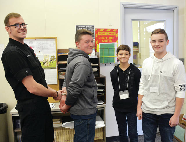 "Wauseon Middle School eighth graders participated in ""Exploring Careers Hands On for 8th Graders"" held at Four County Career Center in Archbold. Career Explorers from FCCC guided the eighth graders through several careers of interest to them as they consider their futures. Shown in the Law Enforcement and Security Tactics lab are, from left, Career Explorer Mark Patterson, Conner Bowers, Jared Lange, and Andrew Malone."