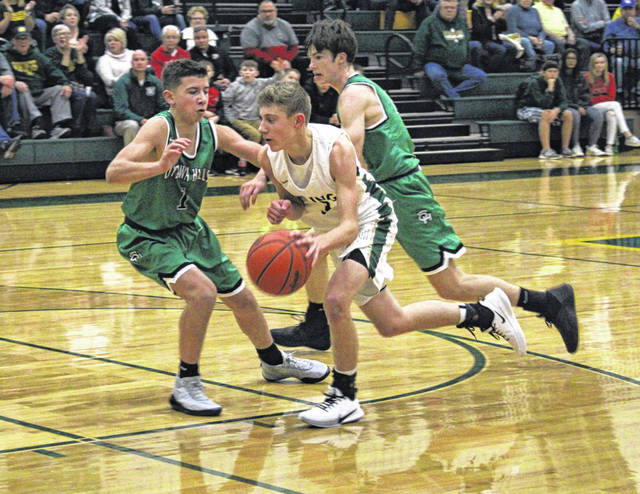 Evan Lumbrezer drives the lane for Evergreen in the season opener versus Ottawa Hills Monday at Evergreen. The Vikings held on for a 44-43 win.