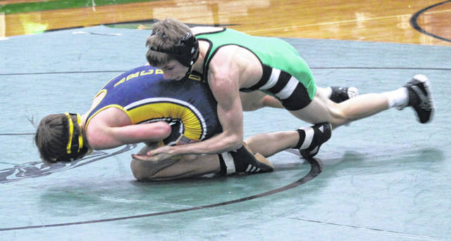 Defending state champion Zack Mattin of Delta, right, pushes around Wyatt Armstrong of Archbold in the 120-pound match during a dual held Thursday at Delta. Mattin pinned Armstrong in 1:33, doing his part in the Panthers' 42-18 win over the Blue Streaks.