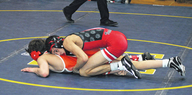 Damon Molina of Wauseon, top, gains the upperhand in a match last season. He returns for the Indians after qualifying for state during the 2018-19 season.