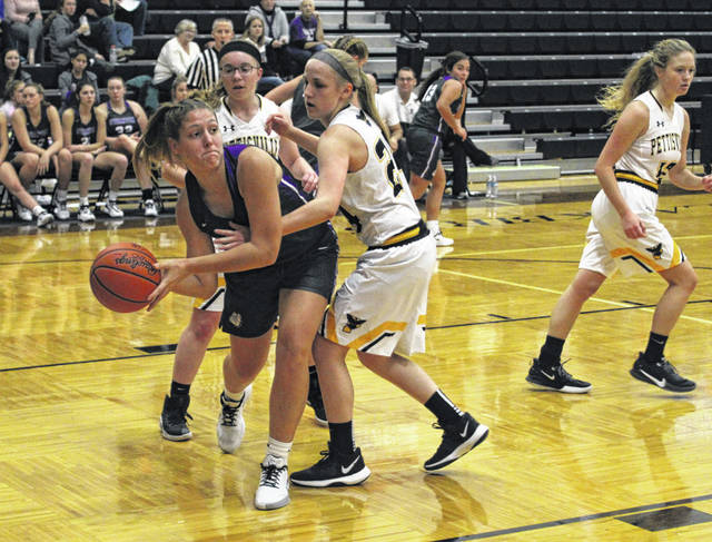 Morgan Pine of Swanton looking to pass after grabbing a rebound during Tuesday's game at Pettisville. The Bulldogs defeated the Blackbirds 43-24.