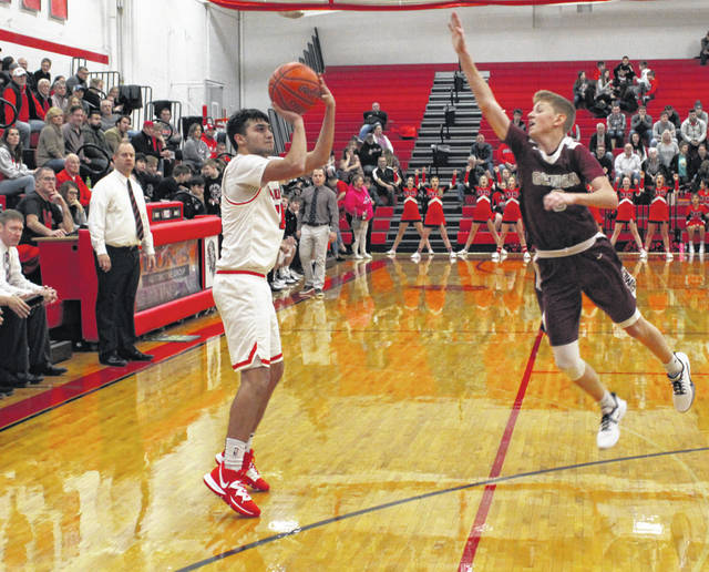 Wauseon's Noah Tester fires up a three-ball during a non-league battle with Genoa Saturday. He paced the Indians with 19 points, leading them to a 56-45 win.