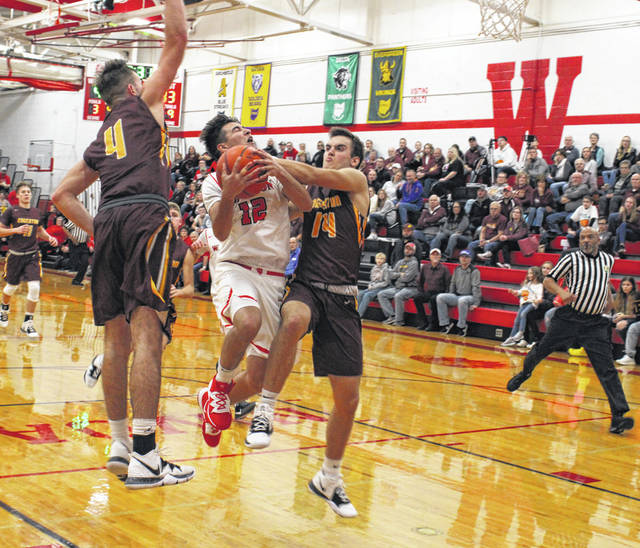 Noah Tester of Wauseon goes up strong looking to draw a foul during Friday's home opener with Edgerton. He finished with 17 points as the Indians defeated the Bulldogs 54-46.