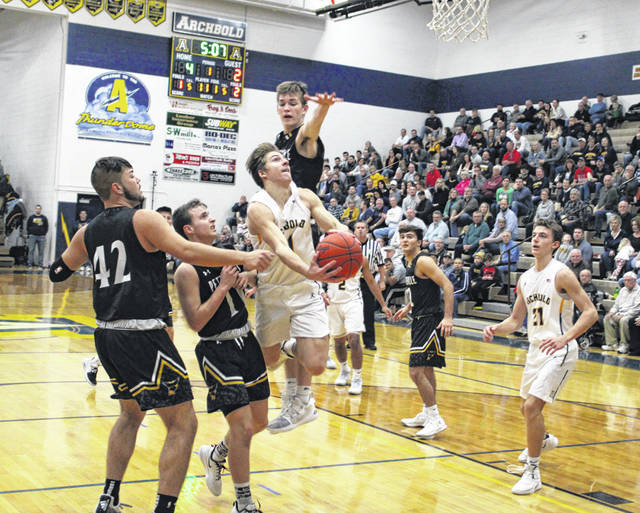 Elijah Zimmerman of Archbold gets through the lane and converts an off-balance shot during Friday's game against Pettisville. He had 11 points for the Blue Streaks in a 51-41 win over the Blackbirds.