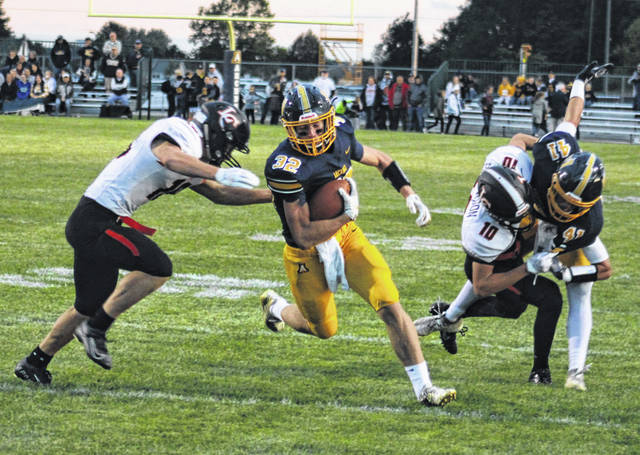 Archbold's Elijah Zimmerman races upfield after making a catch in a regular season game with Liberty Center this season. On the defensive side, Zimmerman was named second team All-Ohio Sunday when the teams were announced for Division VI.